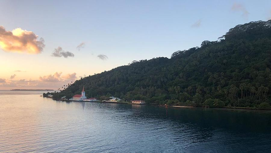 The view from MS Paul Gauguin pulling into Taha'a at sunset.