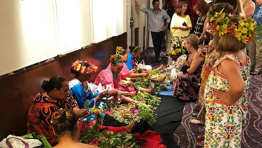 Polynesian Night onboard MS Paul Gauguin. Locals from Moorea come to teach lei making and head dress making.