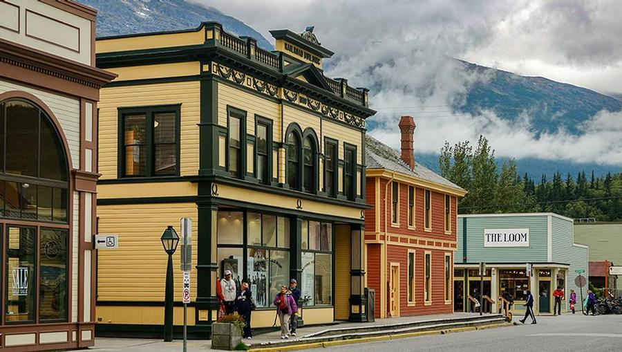 A view of small stores and buildings in Skagway, Alaska.