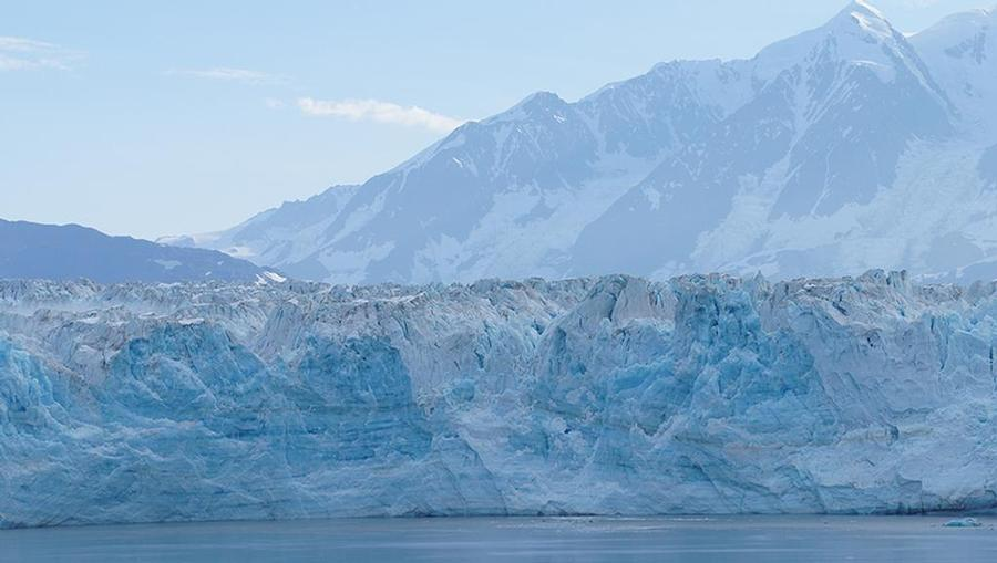 A view from the water of Wrangell-St. Elias National Park and Preserve and it's icy glaciers in Alaska near the gulf.