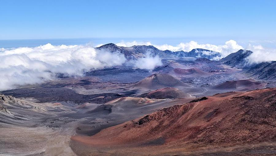 A beautiful shot of Haleakala National Park overlooking mountains and dormant volcano craters in Maui, Hawaii.