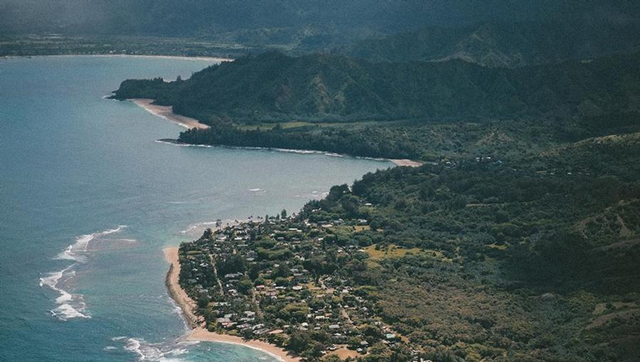 A bird's eye view of the lush Maui coast from a helicopter.